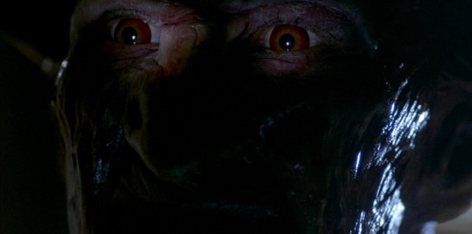Close up shot of Freddy (Robert Englund) in  A Nightmare On Elm Street Part 2: Freddy's Revenge