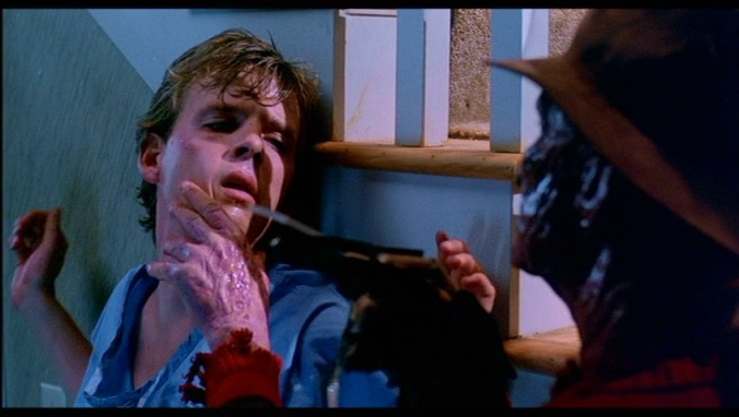 Jesse (Mark Patton) and Freddy (Robert Englund) in  A Nightmare On Elm Street Part 2: Freddy's Revenge