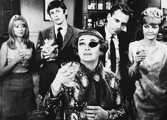 Bette Davis, Shelia Hancock and the cast in a black and white still from The Anniversary (1968)
