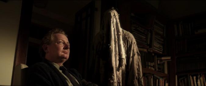 Cameron Rhodes as Dennis in 'Housebound'